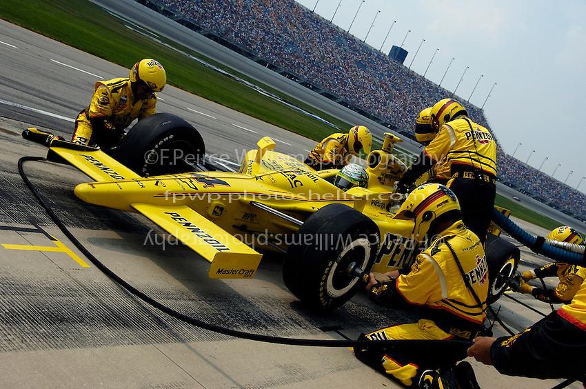 11 September, 2005, Joliet,IL,USA<br /> Tomas Scheckter makes a pit stop.<br /> Copyright&copy;F.Peirce Williams 2005
