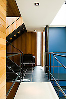 The interior of the property involves the use of a series of connecting staircases and walkways