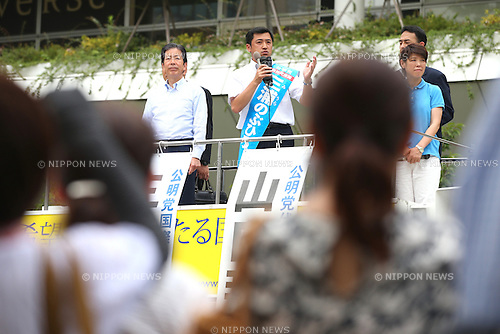 Komeito party leader Natsuo Yamaguchi, left, attends a stump speech in support of Nobuhiro Miura, a local candidate in Kawasaki, near Tokyo, Japan on July 8, 2016. Japan's upper house election will be held on this sunday. (Photo by AFLO)