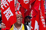 Left wing and student activists march during a protest rally organised by left wing groups and Doro Chiba labour union. Tokyo, Japan Sunday June 14th 2009