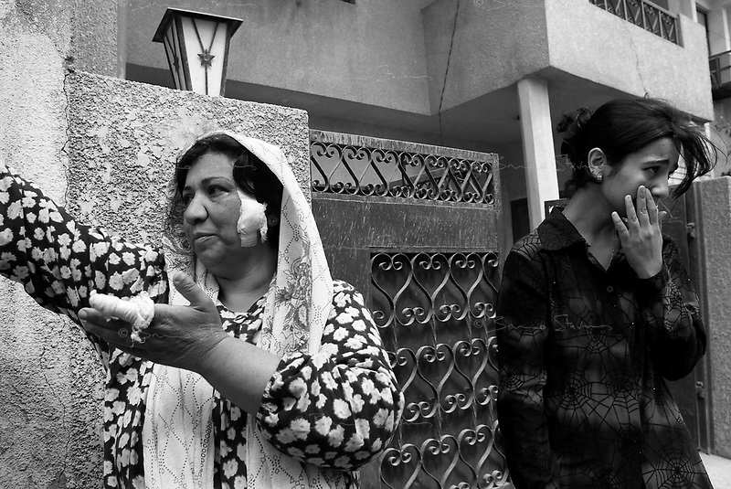 Baghdad, Iraq, March 26, 2003.Sunduz Abdel Karim, 43, left, and her daughter Russul Sabri, 18, right, cry as they recall the untimely death of 5 of their neighbours as a result of a US bomb falling on a civilian house in Adamiyeh..They were both slightly injured by flying glass in the event.
