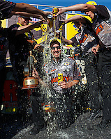 May 15, 2016; Commerce, GA, USA; Crew member John Walton is doused by NHRA funny car driver Matt Hagan and crew members as they celebrate his first career victory as a crew member after winning the Southern Nationals at Atlanta Dragway. Mandatory Credit: Mark J. Rebilas-USA TODAY Sports