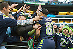 Seattle Seahawks punt return specialist and wide receiver Golden Tate (81)celebrates with fans after their 27-24 win over the Tampa Bay Buccaneers in  at CenturyLink Field in Seattle, Washington on  November 3, 2013.  Tate returned three punts for 92 yards in the Seahawks come from behind 27-24 win over the Buccaneers.  ©2013. Jim Bryant. All Rights Reserved.