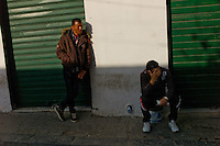 Tripoli, Libya, March 27, 2011..Street money changers, the Libyan dinar has lost about 50% of its value against the U.S. dollar. Ten days after the beginning of the Coalition military operation over Libya, economic standstill and uncertainty about the future weigh heavily toll on the population's morale..