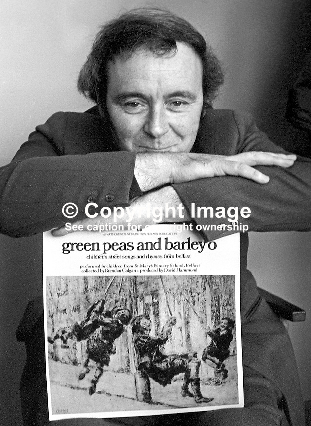 "David Hammond, writer, singer, teacher, songwriter, historian, musician, film-maker, broadcaster, Belfast, N Ireland, with one of his LPs of local street songs titled  ""green peas and barley o"". 197504000337c..Copyright Image from Victor Patterson, 54 Dorchester Park, Belfast, United Kingdom, UK...For my Terms and Conditions of Use go to http://www.victorpatterson.com/Victor_Patterson/Terms_%26_Conditions.html"