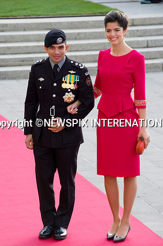 "PRINCE RASHID AND PRINCESS ZEINA OF JORDAN.Wedding of HRH the Hereditary Grand Duke and Countess Stéphanie de Lannoy.Religious Ceremony at Cathedral of Our lady of Luxembourg, Luxembourg_20-10-2012.Mandatory credit photo: ©Dias/NEWSPIX INTERNATIONAL..(Failure to credit will incur a surcharge of 100% of reproduction fees)..                **ALL FEES PAYABLE TO: ""NEWSPIX INTERNATIONAL""**..IMMEDIATE CONFIRMATION OF USAGE REQUIRED:.Newspix International, 31 Chinnery Hill, Bishop's Stortford, ENGLAND CM23 3PS.Tel:+441279 324672  ; Fax: +441279656877.Mobile:  07775681153.e-mail: info@newspixinternational.co.uk"