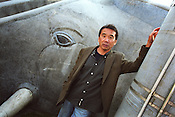 Haruki Murakami, born 1949,  Japanese contemporary fiction author / novelist / essayist. Photographed in Kagurazaka district of Tokyo, Japan. 14.12.2004 Murakami is author of noted books such as 'The Elephant Vanishes', 'Norwegian Wood', 'A Wild Sheep Chase', 'Underground', 'After the quake' and 'Kafka on the Shore'.