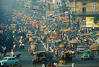 People, rickshaws and cars in a crowded busy street in rush hour, Delhi, India RESERVED USE - NOT FOR DOWNLOAD -  FOR USE CONTACT TIM GRAHAM