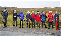 BNPS.co.uk (01202 558833)<br /> Pic: G&amp;J Surveys/BNPS<br /> <br /> ***Please use full byline***<br /> <br /> The Survey Team for Knight's Peak prepare to leave.  L-R Alan Dawson, Andy Nisbet, Iain Brown, David Batty, Iain Robertson, Colin Walter, Alan Brook, John Barnard and Graham Jackson.<br /> <br /> Three ramblers have stripped a remote mountain in the Scottish Highlands of its status after measuring it at six inches below the official height.<br /> <br /> Intrepid hillwalkers John Barnard, Graham Jackson and Myrddyn Phillips set out to complete Britain's most daring mountain survey on Knight's Peak on the Isle of Skye.<br /> <br /> Maps list the jagged rocky peak in the Cuillin mountain range at 3,002ft high, just two feet above the 3,000ft required height for mountain status.<br /> <br /> However it has long been a source of controversy among hillwalkers who suspected it fell short of the height given on the maps.