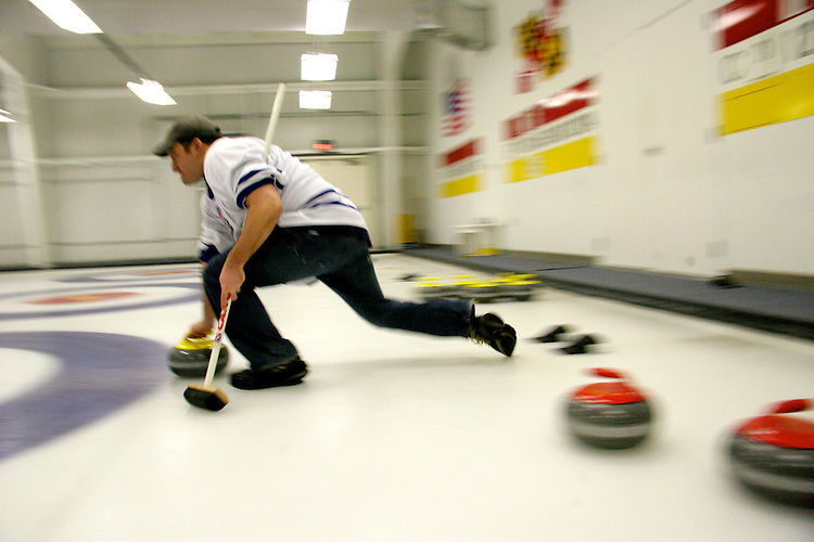 Mike Panetta, captain of the Washington, D.C., curling team, sends the stone towards a tee during a team practice at the National Capital Curling Center in Laurel, Md. Panetta is trying to form a D.C. Olympic delegation to highlight the lack of voting rights for District residents.