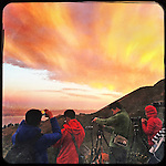 Photographers line up at the Marin Headlands to capture the sunset and moonrise in Sausalito, CA.