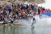 """Cushing Classic at Squaw Valley 11"" - Photograph of a skier crossing a pond during the Cushing Classic at Squaw Valley, USA."