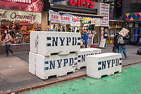 Barricades sit on Broadway just north of Times Square in preparation for New Year's Eve, seen on Sunday, December 22, 2013. (© Richard B. Levine)