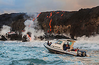 A boat tour takes visitors to the lava ocean entry point near Kalapana on the Big Island of Hawai'i.