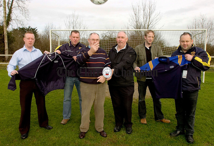 L-R Chris Varian,O'Neills Sports ,Andy O'Mahony,Newtown Manager,Jim Madden, Chairman Clare Soccer League ,Seamus Hayes,Clare Champion Sports Editor,Noel Donnelan, Newtown Captain and Bernard Kilmartin, Newtown Treasurer.Pic Arthur Ellis.
