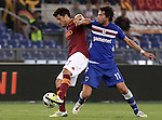 Calcio, Serie A: Roma vs Sampdoria. Roma, stadio Olimpico, 26 settembre 2012..AS Roma midfielder Marquinho, of Brazil, left, is challenged by Sampdoria midfielder Gianni Munari during the Italian Serie A football match between AS Roma and Sampdoria at Rome's Olympic stadium, 26 September 2012..UPDATE IMAGES PRESS/Riccardo De Luca