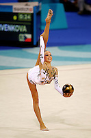 Dominika Cervenkova of Czech Republic holds balance with ball during qualifications round at the Athens Olympic Games on August 26, 2004 at Athens, Greece. (Photo by Tom Theobald)