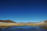 Altiplano lake and mountains between Potosi and Uyuni, Bolivia