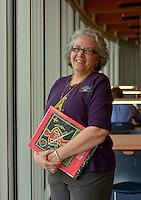 NWA Democrat-Gazette/BEN GOFF -- 02/23/15 Tamara Burgh of Bella Vista poses for a photo while volunteering in the library at Crystal Bridges Museum of American Art in Bentonville on Monday Feb. 23, 2014.
