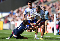 Alesana Tuilagi of Samoa gets past Chris Wyles of the USA. Rugby World Cup Pool B match between Samoa and the USA on September 20, 2015 at the Brighton Community Stadium in Brighton, England. Photo by: Patrick Khachfe / Onside Images