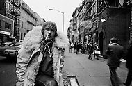 December 1969, Manhattan, New York City, New York State, USA --- French actor Yves Renier smokes a cigarette as pedestrians walk past in New York's East Village. --- Image by © JP Laffont