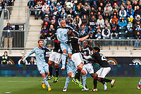 Aurelien Collin (78) goes up for a header  during the first half against the Philadelphia Union during a Major League Soccer (MLS) match at PPL Park in Chester, PA, on March 2, 2013.