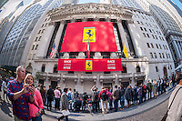 The New York Stock Exchange is decorated on Wednesday, October 21, 2015 for the initial public offering of the luxury sports car manufacturer Ferrari. Fiat Chrysler owns 90% of Ferrari and the company will trade under the ticker RACE. (© Richard B. Levine)