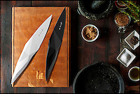 BNPS.co.uk (01202 558833)<br /> Pic: KlivissonCampelo/BNPS<br /> <br /> In ceramic or stainless steel.<br /> <br /> Yabadabadoo - Paleolithic panache for the kitchen.<br /> <br /> Foodies wanting to release their inner caveman now have the perfect tool - A kitchen blade based around a 20,000 year old stone age knife.<br /> <br /> The designers have gone back to basics to craft a utensil that sits in the hand in an organic and natural way that harks back to the dawn of time.<br /> <br /> The Stone Age IP Knife has a handle designed to look like the primitive tools that prehistoric man would have carved from stone and used to cut up animal carcasses.