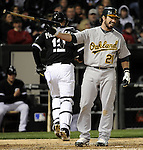 CHICAGO - APRIL 12:  Andy LaRoche #21 of the Oakland Athletics reacts after striking out against the Chicago White Sox on April 12, 2011 at U.S. Cellular Field in Chicago, Illinois.  The White Sox defeated the Athletics 6-5.  (Photo by Ron Vesely)  Subject:  Andy LaRoche