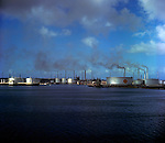 Chimneys and storage tanks at Curaco oil refinery, Netherland Antilles. 1975