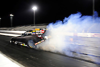 Jan. 16, 2012; Jupiter, FL, USA: NHRA funny car driver Jeff Arend does a burnout during testing at the PRO Winter Warmup at Palm Beach International Raceway. Mandatory Credit: Mark J. Rebilas-