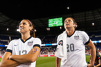 United States (USA) forward Alex Morgan (13) and forward Abby Wambach (20) watch a video tribute to the career of Abby Wambach after the match. The women's national team of the United States defeated the Korea Republic 5-0 during an international friendly at Red Bull Arena in Harrison, NJ, on June 20, 2013.