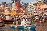 Tourists in boat advertising TATA Indicom on River Ganges at Varanasi, Benares, Northern India