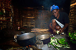 Early in the morning, Imaculador Dupres prepares to cook bananas for breakfast in her home in Despagne, a rural village in southern Haiti where the Lutheran World Federation has been working with residents to improve their quality of life.