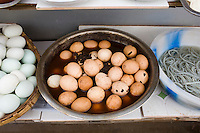 Preserved '1000 year old' eggs (6 months old), on display at food stall in Fengdu, China