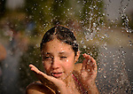 People playing in water in a park of Madrid on August 9, 2012 for a day of high temperatures in Spain . (C) Pedro ARMESTRE