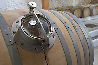 Fermentation in barrel. Oak barrel aging and fermentation cellar. Chateau Liversan, Domaines Lapalu, Haut Medoc, Bordeaux, France