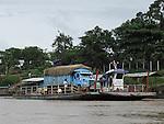 A truck on a ferry on the Madre de Dios River in Puerto Maldonado Peru