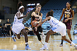 21 November 2015: Iona's Marina Lizarazu (ESP) (1) gets past the North Carolina's N'Dea Bryant (22) and Destinee Walker (24) as Iona's Karynda DuPree (10) watches. The University of North Carolina Tar Heels hosted the Iona College Gaels at Carmichael Arena in Chapel Hill, North Carolina in a 2015-16 NCAA Division I Women's Basketball game. UNC won the game 64-52.