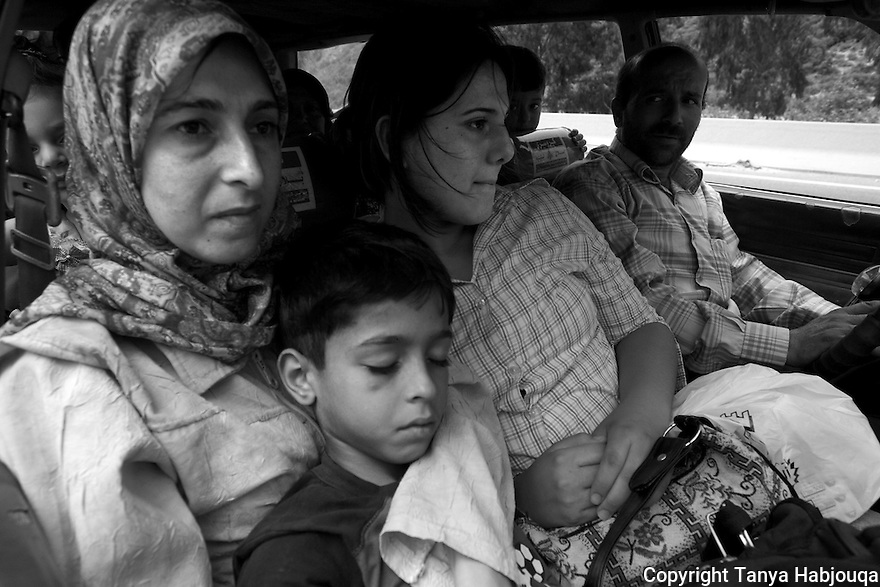 A family of 13 squeeze into one station wagon fleeing to the violence in the South. They said they prayed for survival but had faith that their fellow Lebanese would take them in.