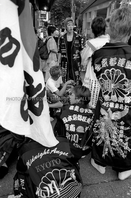 July, 2001--Kyoto, Japan..Right wing 'bosozoku' motorcylce gangs march during the annual Gion festival on Shijo Street...All photographs ©2003 Stuart Isett.All rights reserved.This image may not be reproduced without expressed written permission from Stuart Isett...Photograph ©2007 Stuart Isett.All rights reserved