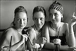 Three teenagers sitting together smoking