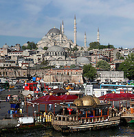 Low angle view of Suleymaniye Mosque or Mosque of Sultan Suleyman the Magnificent (Suleymaniye Camii) 1550-58, by Mimar Sinan, Istanbul, Turkey. Commissioned by Suleiman the Magnificent, and located on Istanbul's Third Hill, Suleymaniye Mosque was restored in 1665 after a fire, in 1766 due to an earthquake and in 1956 after damage in World War I. The mosque itself is preceded by a monumental courtyard (avlu). At the four corners of the courtyard are the four minarets. The dome is buttressed by two half-domes and two typanum walls. The historical areas of the city were declared a UNESCO World Heritage Site in 1985. Picture by Manuel Cohen.