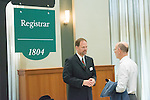 """Associate University Registrar Patrick Beatty (Left) talks with the College of Arts and Sciences Dean Robert Frank at """"Your Passport to The OHIO Guarantee"""". Photo by Ben Siegel/ Ohio University"""