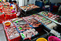 A Mexican woman selects from a wide variety of fish available at the seafood and fish market in Veracruz, Mexico, 29 June 2015.