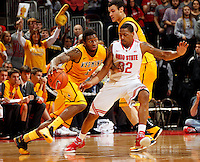 Ohio State Buckeyes guard Lenzelle Smith Jr. (32) guards Wyoming Cowboys guard Charles Hankerson Jr. (1) during the second half of the NCAA basketball game at Value City Arena in Columbus on Nov. 25, 2013. The Buckeyes won 65-50. (Adam Cairns / The Columbus Dispatch)