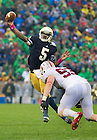 Oct. 13, 2012; Notre Dame quarterback Everett Golson is pressured by Stanford linebacker Trent Murphy during the second quarter. Photo by Barbara Johnston/University of Notre Dame