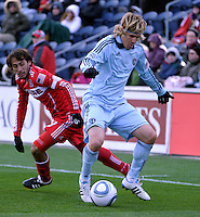 Sporting KC defender Chance Myers (7) plays the ball in front of Chicago Fire forward Gaston Puerari (18).  The Chicago Fire defeated Sporting KC 3-2 at Toyota Park in Bridgeview, IL on March 27, 2011.