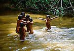 Parima Tapirapeco protects both the headwaters of the Orinoco River and the natural and cultural space of the Yanomamo people.  Children play in the clear water of an Amazonian creek.