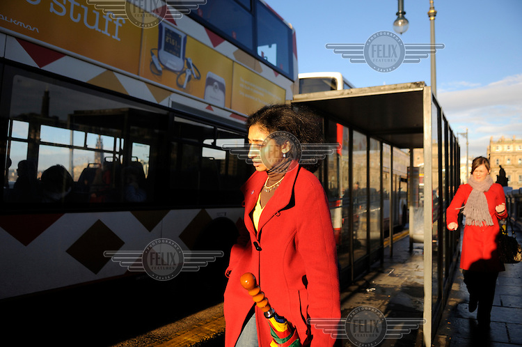A woman of South Asian descent on North Bridge, Edinburgh.